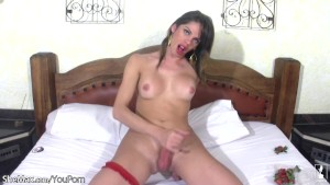 Big cocked shemale sticks strawberries in her spread asshole