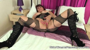 UK milf Christina X finger fucks in PVC and nylon tights