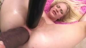 Blonde takes big anal dildo