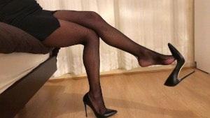 Teasing and dangling in black heels and fishnet