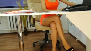 Secretary in tight orange dress getting caught on