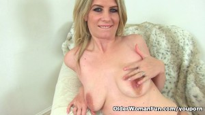 British milf Ashleigh squeezes her leaking nipples