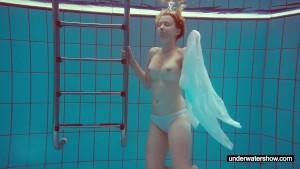 Cute Melissa plays underwater