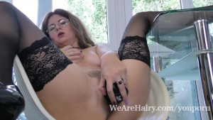 Elena V masturbates with her black dildo in chair