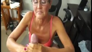 Mature lady sucking and jerking a dick