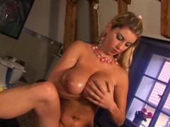 Busty Snow Oils Her Large Tits