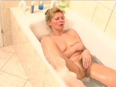 Older lady and her new bath toy 1/3