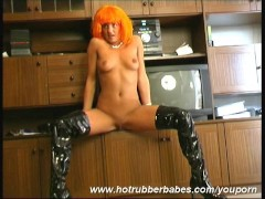 Cisara in black latex boots at home