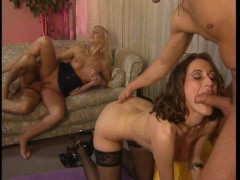 Two guys empty their ball bags onto some hot girls