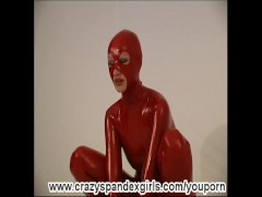 Susi strips in lycra catsuit