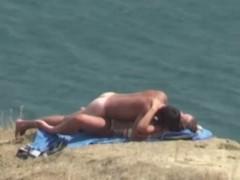 Nudists fucking on the beach