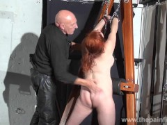 : Swedish amateur submissive Vicky Valkyries dungeon bondage and whipping post spanking of chubby enslaved redhead in bdsm and pain