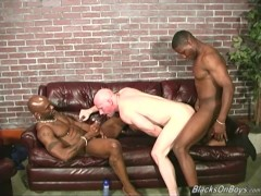 Bald white man gets fucked by two black men