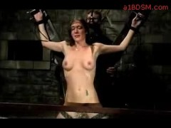 View Girl Tied To Wheels Tortured With Water By Master And Other Girl Fucked With Dildo In The Dungeon