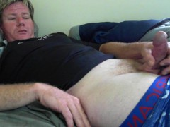 guy plays with his bulge and cock