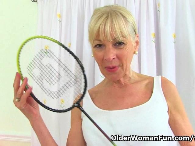 image English gilf elaine sticks a badminton racket up her pussy