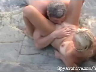 Voyeur video of a horny mature couple having sex