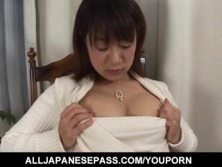 Smoking cutie Shinobu Mizushima with nice legs rubs pussy on chair arm