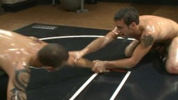 Two ripped studs wrestle...